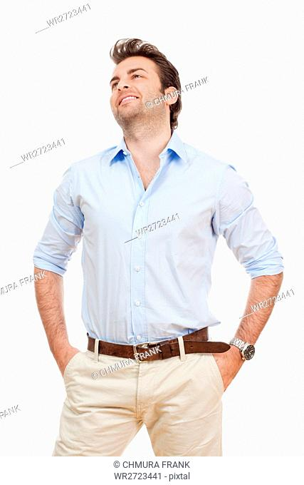 businessman in blue shirt and light trousers standing, looking - isolated on white