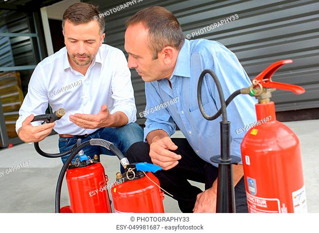 instructor explaining how to use fire extinguisher