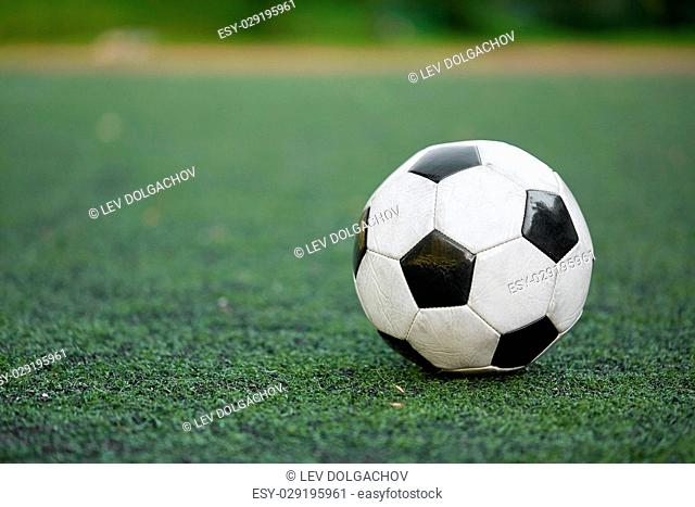 sport, soccer and game - ball on football field
