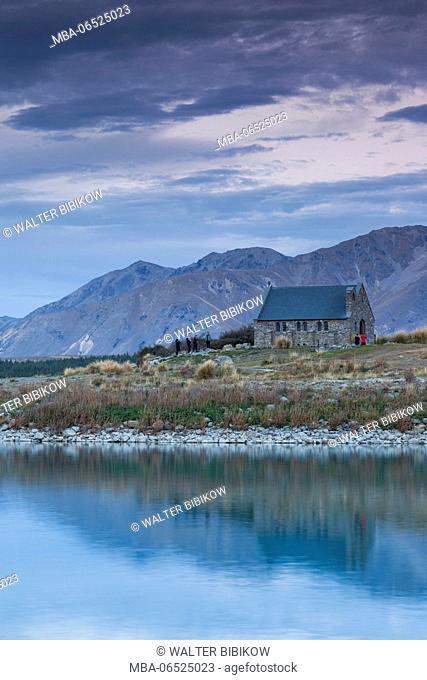New Zealand, South Island, Canterbury, Lake Tekapo, Church of the Good Shepherd, elevated view with the Tekapo River, dusk