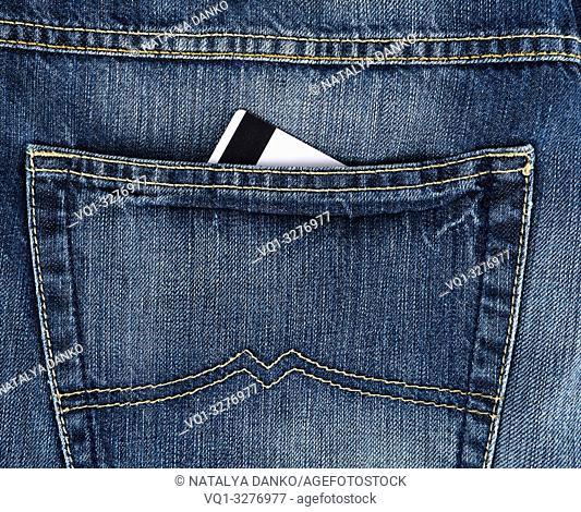 credit card in the back pocket of blue jeans, full frame