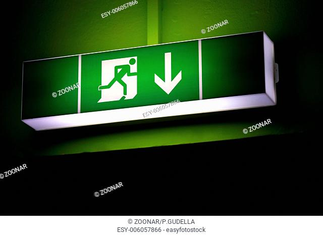 Emergency exit sign with green background