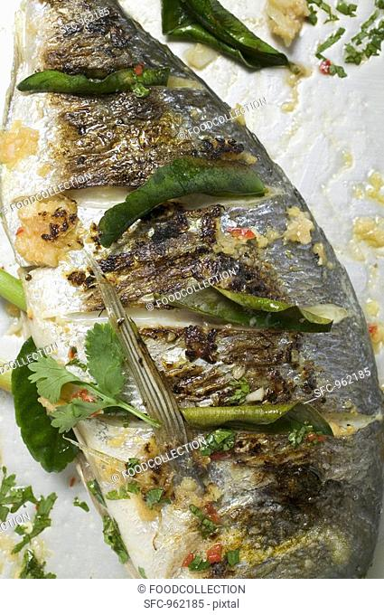 Roasted gilthead bream with lemon leaves