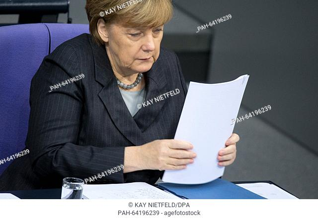 German chancellor Angela Merkel (CDU) attends a session of the German parliament (Bundestag) in Berlin, Germany, 04 December 2015