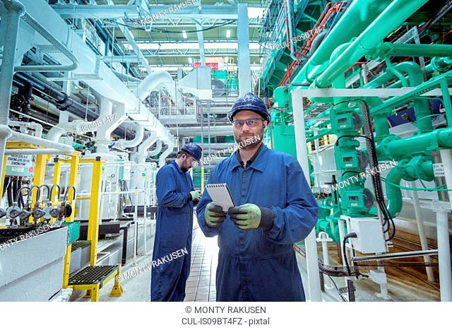 Portrait of engineer in turbine hall in nuclear power station