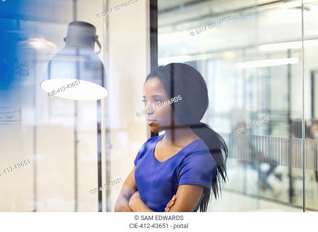 Focused, determined businesswoman in office