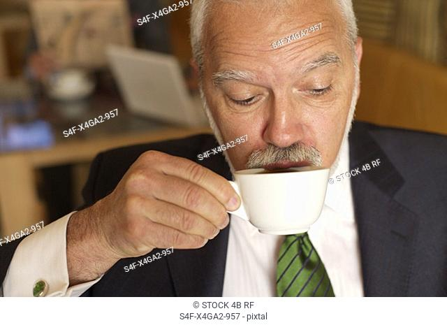 Mature businessman drinking a cup of coffee