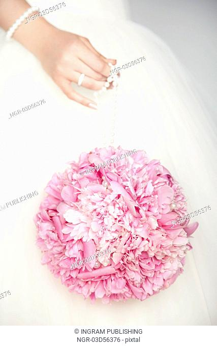Wedding bouquet in hands of bride. Wedding photo
