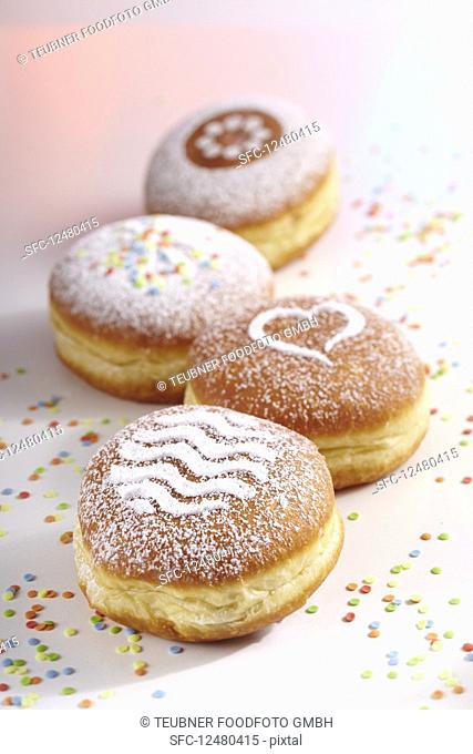 Doughnuts for carnival with various icing sugar patterns