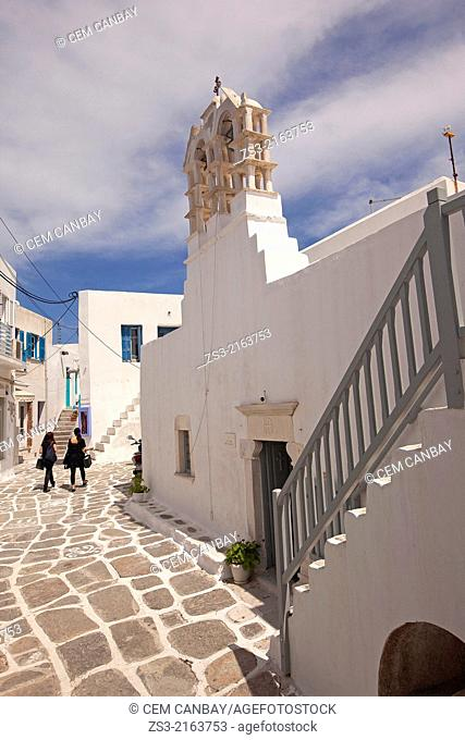 Women in black dress in front of a church in Naoussa town, Paros, Cyclades Islands, Greek Islands, Greece, Europe