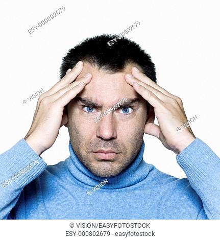 expressive portrait on isolated background of a stubble man headache massaging head