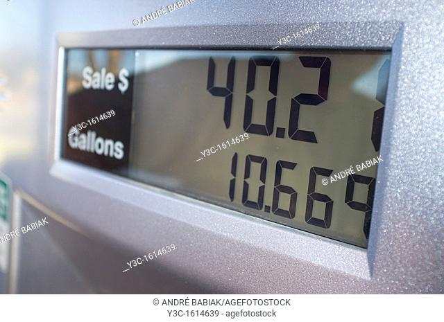 Display of fuel pump showing gallons and price at gas station