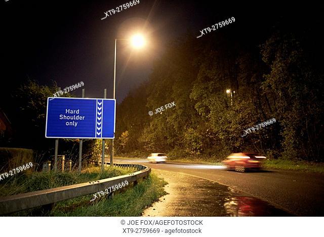 cars on motorway on slip at night on the M2 Newtownabbey northern ireland uk