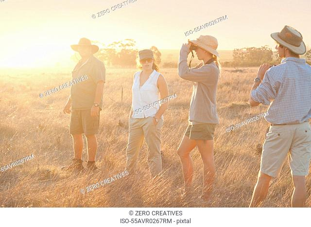 People using binoculars on a safari, Stellenbosch, South Africa
