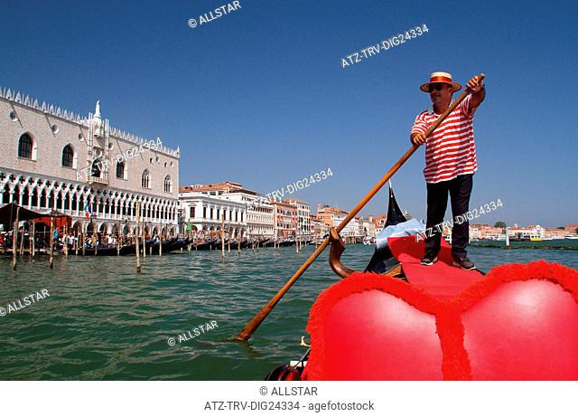 GONDOLIER IN RED HOOPS; GRAND CANAL, VENICE, ITALY; 04/08/2014
