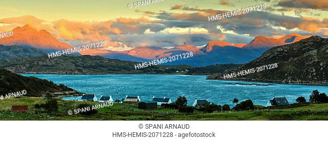 United Kingdom, Scotland, Wester Ross, Loch Torridon, panoramic landscape of a fisherman village at sunset on the edge of a bay with calm waters