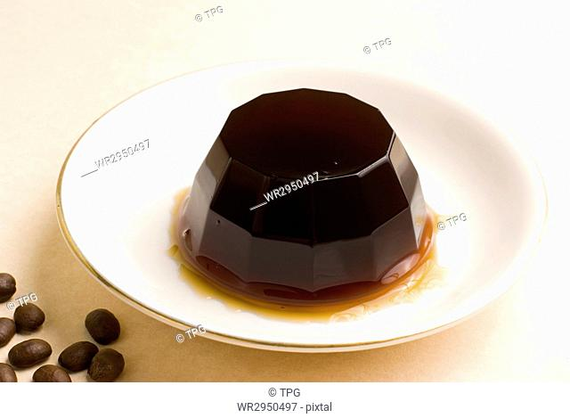 Coffee pudding on white ceramic dish, sweet dessert
