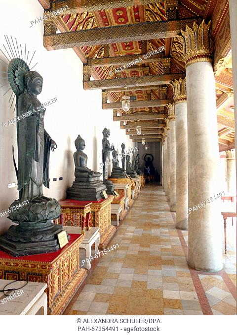 A portico featuring various Buddha statues at Wat Benchamabophit inBangkok,Thailand, 04 March 2016. The temple located in the Dusit district of Bangkok is...