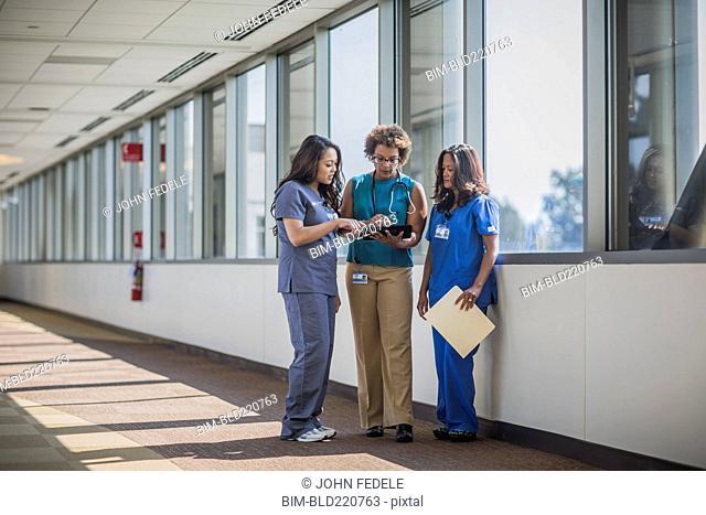 Nurses and doctor using digital tablet