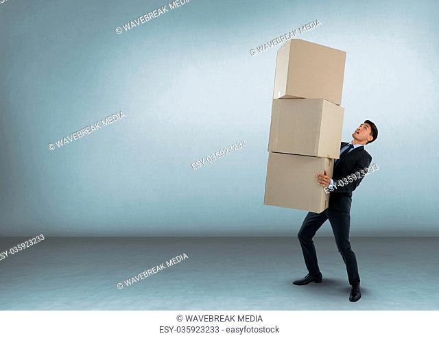 Businessman carrying boxes in room