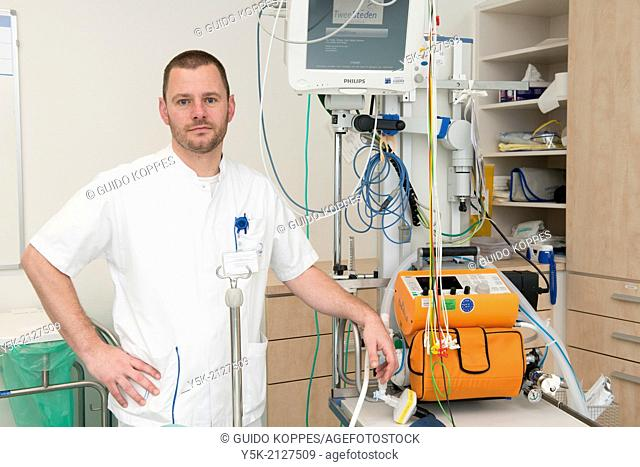 Tilburg, Netherlands. Male paramedic, working in an hospitals trauma room and responsible for respiration related monitoring and trouble shooting