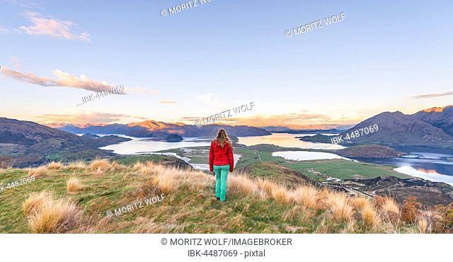 Hiker overlooking Lake Wanaka and mountains, sunset, Rocky Peak, Glendhu Bay, Otago, Southland, New Zealand