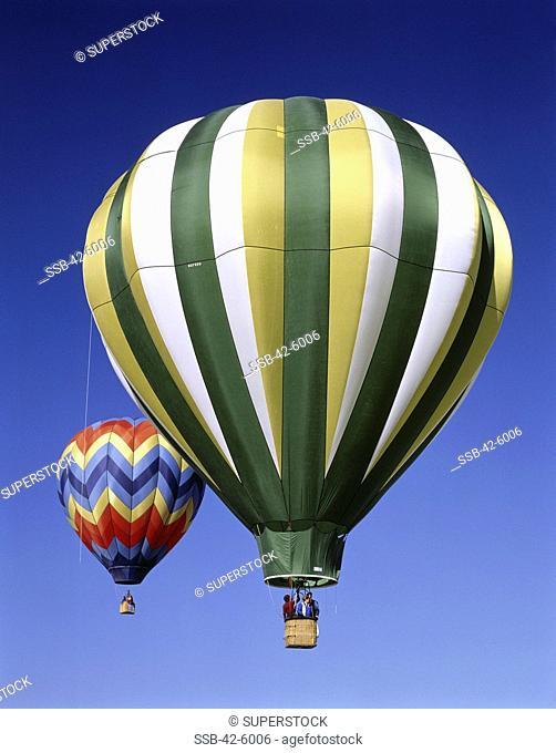 Low angle view of hot air balloons rising, Albuquerque International Balloon Fiesta, Albuquerque, New Mexico, USA