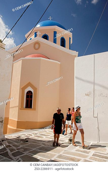Tourists walking around a colorful church in Hora, Serifos, Cyclades Islands, Greek Islands, Greece, Europe