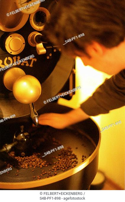 Man grinds Coffee Beans - Munich - Bavaria - Germany