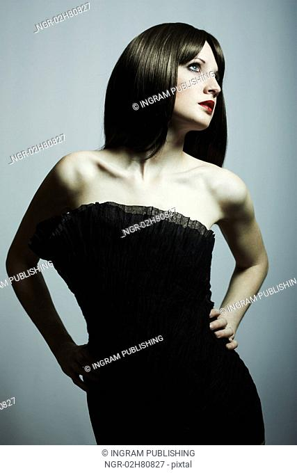 Fashion portrait of young beautiful elegant woman in the black dress