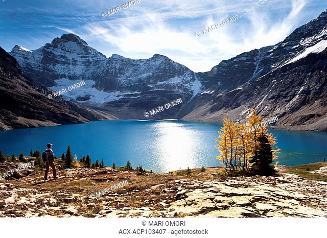 A hiker approaches Lake McArthur in Yoho National Park. Model release signed