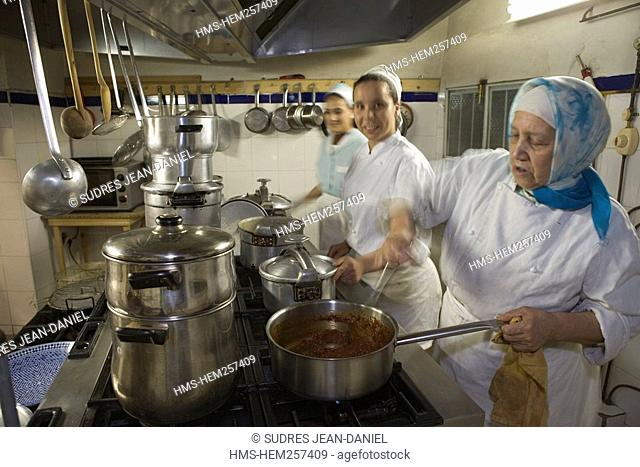 Morocco, Middle Atlas, Fez, Imperial City, Fez El Bali, medina listed as World Heritage by UNESCO, Riad El Ghalia, women preparing the diner
