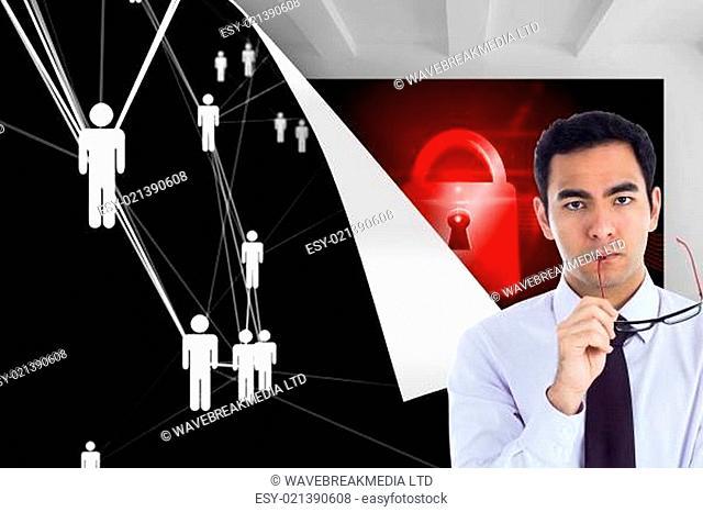 Composite image of unsmiling businessman holding glasses