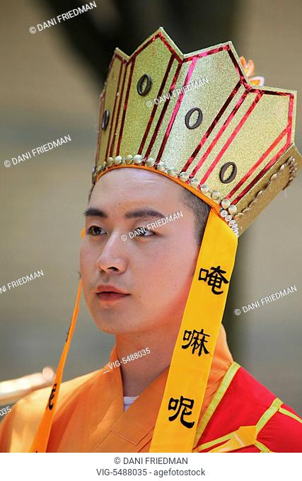 CANADA, MISSISSAUGA, 28.05.2016, Chinese Buddhist Shaolin monk dressed as Lord Buddha during a religious procession celebrating the festival of Vesak in...