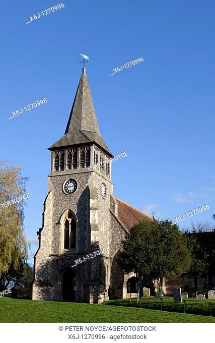 The Parish Church of St Nicholas, Wickham Village church on a hill with shingle spire