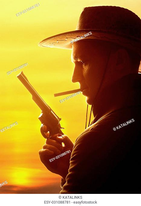 cowboy in hat with cigar and revolver silhouette