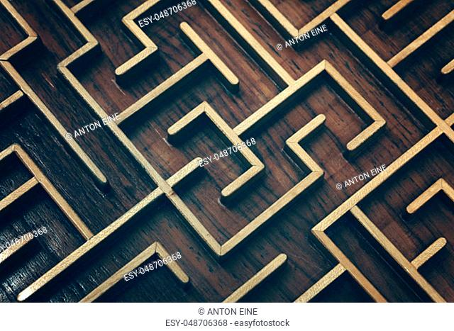 Close up of dark brown wooden labyrinth maze, toy puzzle game, elevated high angle view