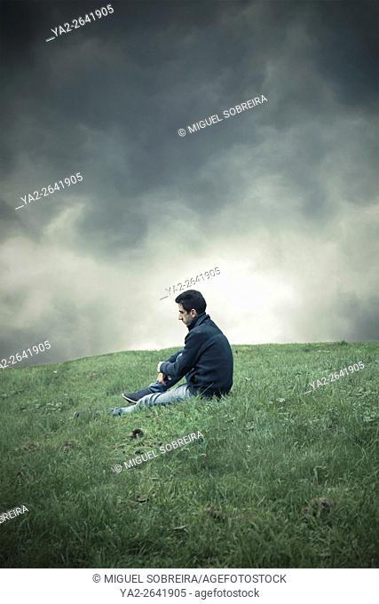 Man Sitting Grassy Top
