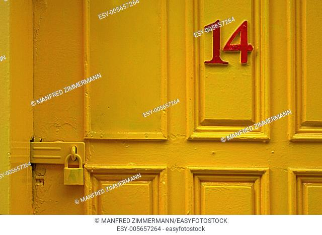 Detail yellow door with red number 14 (Ireland)