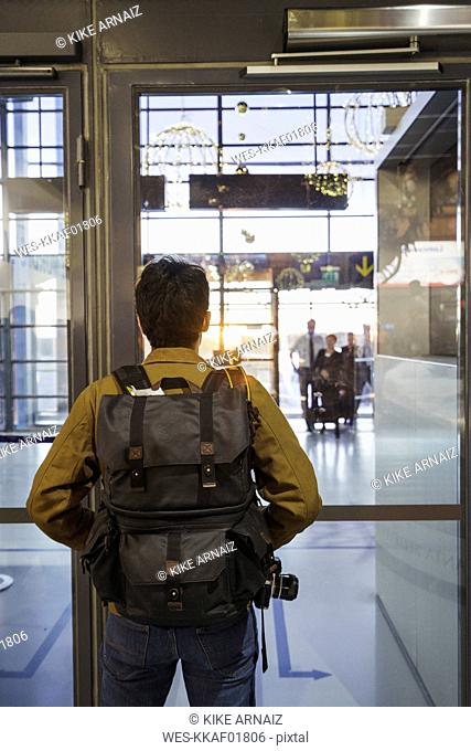 Young man with backpack standing at the airport