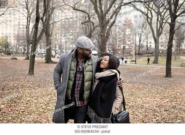 Romantic couple strolling in park, New York, USA