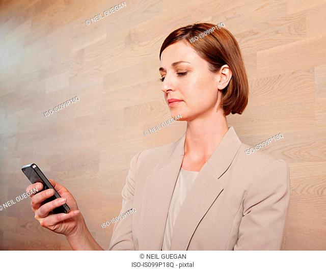 Mid adult woman texting, portrait
