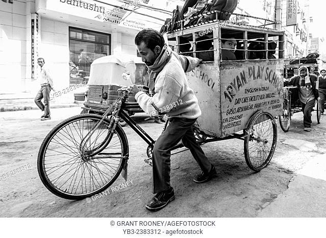 School Children Being Taken To School By Rickshaw Taxi, New Delhi, India