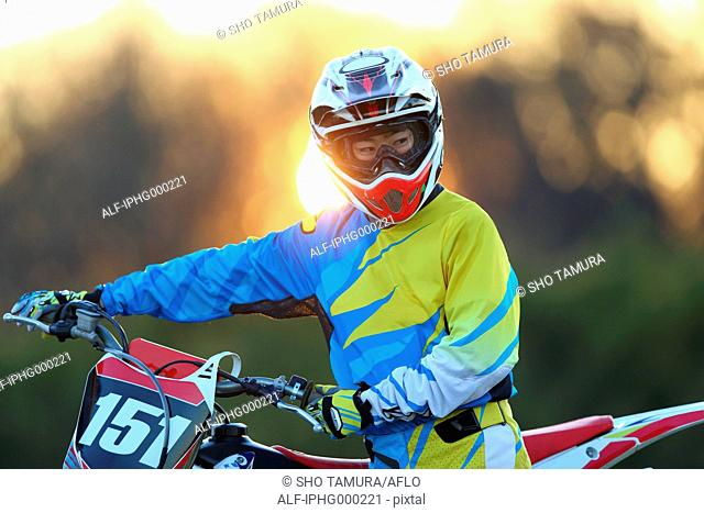 Motocross biker on dirt track