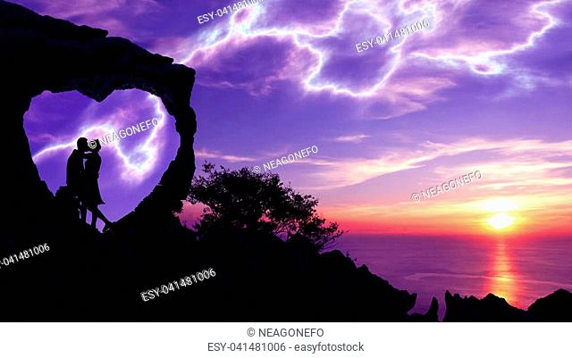 Silhouette Valentine background concept, Couple kissing in a heart-shaped stone on a mountain with purple sky sunset and lightning background
