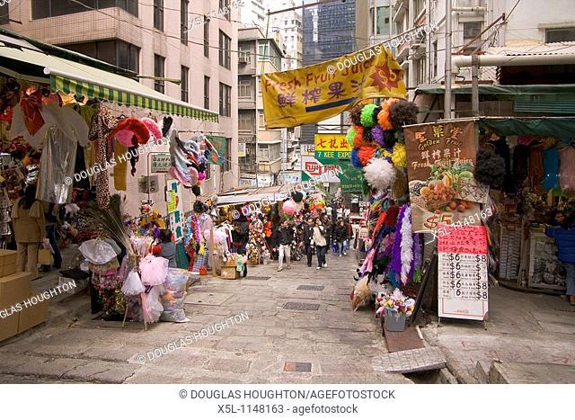 Pottinger Street CENTRAL HONG KONG People cloth stalls alley