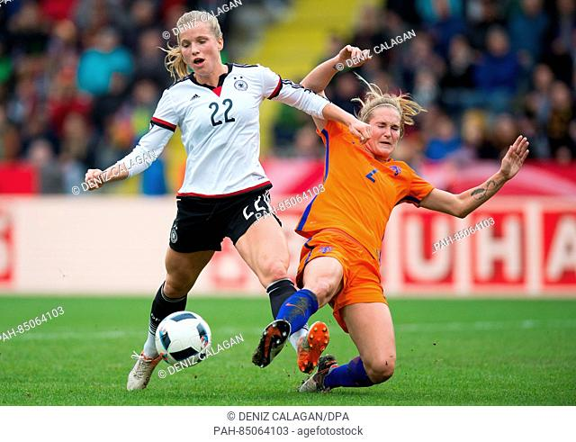 Germany's Tabea Kemme (L) and the Netherland's Desiree van Lunteren vie for the ball during the women's international soccer match between Germany and the...