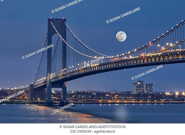 Verrazano Narrows Bridge Moon - View to Verrazano Narrows Bridge, the New York Harbor under a full moon during the blue hour at twilight