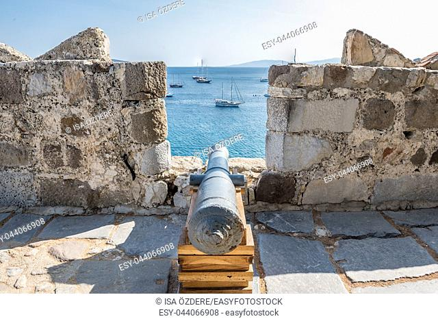 Aerial view of ancient disused cannon and Bodrum Marine with yachts from top of St. Peter Castle or Bodrum Castle in Turkey