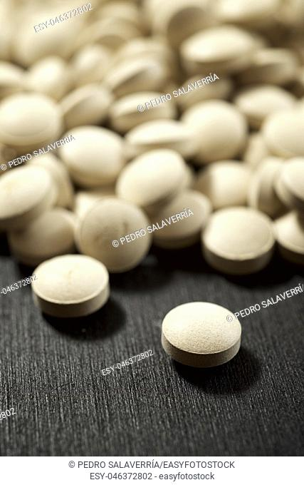 Beer yeast pills on a black table